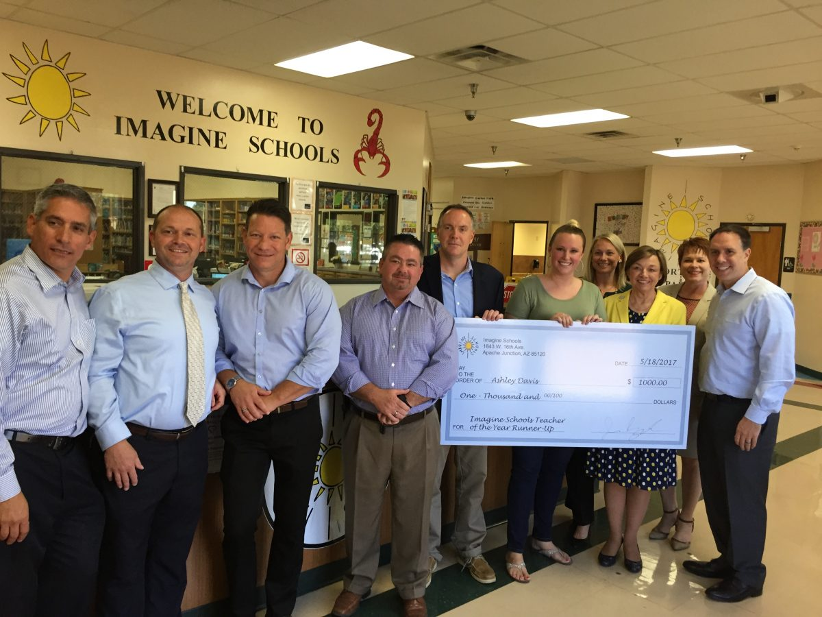 Ashley Davis (center of award check), first grade ELL teacher at Imagine Cortez Park in Phoenix, AZ, receives the 2017 National Teacher of the Year Runner-Up award from Jason Bryant, CEO (left of Ashley) and Dr. Nancy Hall, Chief Academic Officer, (right of Ashley), along with several regional and national leaders.