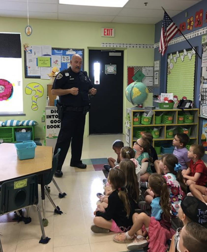 Officer Kevitt, Imagine South Lake's wonderful School Resource Officer talking to kindergarten scholars about school safety. Thank you, Officer Kevitt!