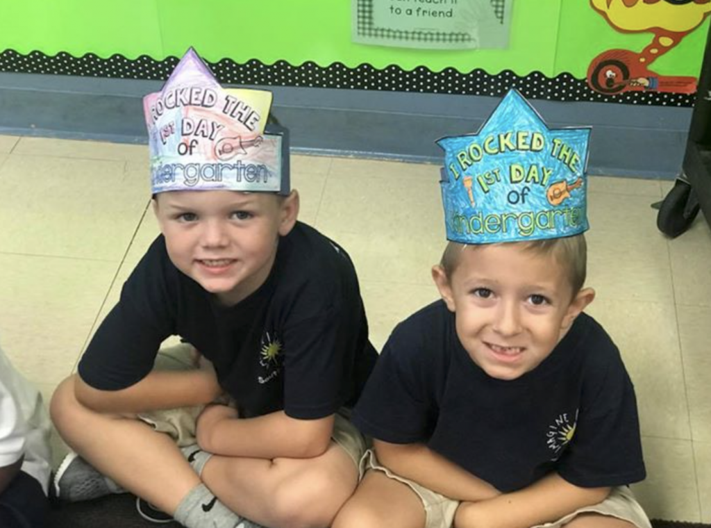 Imagine South Lake kindergarten scholars wear celebratory crowns and smiles on their first day.